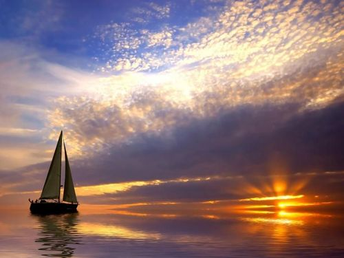 Romantic sailing with a beautiful sunset in a tropical place. by wildfl
